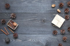 Gift, card, pine cones and cinnamonin Royalty Free Stock Photography
