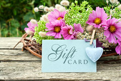 Gift card. Pink flowers with gift card Stock Photo