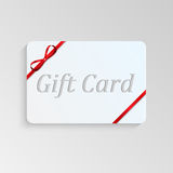 Gift card. With a red bow Stock Images