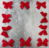 Gift card with red bows Royalty Free Stock Images