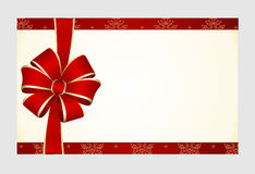 Gift  Card with Red Satin Gift Bow, has space for text on  background. Stock Photos