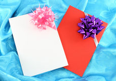 Gift card with ribbon. On blue satin Stock Photo