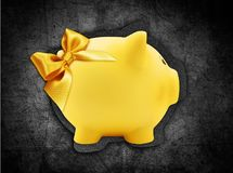 Gift card in the shape of a piggy bank with golden ribbon bow is Stock Photo