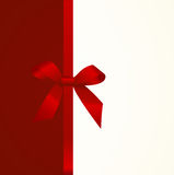 Gift  Card with Shiny Red Satin Gift Bow Close up Stock Photo