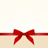 Gift  Card with Shiny Red Satin Gift Bow Close up Royalty Free Stock Photos
