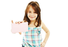 Gift card sign little girl. Excited little girl showing empty blank paper note copy space Royalty Free Stock Photos