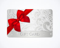 Gift card,  silver Gift coupon with red bow ribbon. Gift coupon, gift card discount, business card with floral scroll, swirl silver swirl pattern, red bow ribbon Royalty Free Stock Image