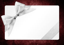 Gift card with silver ribbon bow Isolated on red backgrou Stock Image