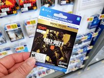 Gift card of a video game in a hand. PLATTSBURGH, USA - JANUARY 21, 2019 : Gift card of Call of Duty Black Ops video game for PS4 in a hand of a buyer at Walmart royalty free stock photography