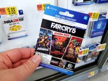 Gift card of a video game in a hand. PLATTSBURGH, USA - JANUARY 21, 2019 : Season Pass card of Far Cry 5 video game in a hand of a buyer at Walmart store stock image