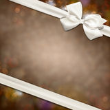 Gift card with white bow. Royalty Free Stock Photography