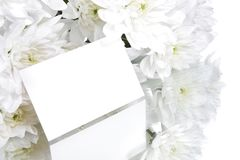 Gift card and white flowers. A bouquet of white flowers with a gift card Stock Photo