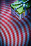 Gift in cardboard box on red striped tablecloth celebrations con Stock Photo