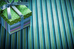 Gift in cardboard box on striped background holidays concept Royalty Free Stock Photo