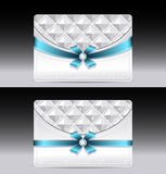 Gift cards with geometric pattern light blue bow r Stock Photography
