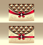 Gift cards with geometric pattern red bow ribbon   Royalty Free Stock Photos