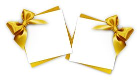 Gift cards with golden ribbon bow  on white. Background Stock Photo
