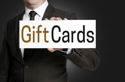 Gift Cards sign is held by businessman Stock Photos