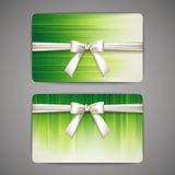 Gift cards with white bows and ribbons Stock Image