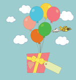 A gift carried by balloons Royalty Free Stock Image