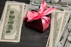 Gift between cash. offer of hand and heart. royalty free stock image