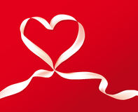 Gift celebration ribbon in heart Stock Photos