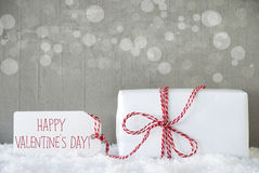 Gift, Cement Background With Bokeh, Text Happy Valentines Day. One Christmas Gift Or Present On Snow. Cement Wall As Background With Bokeh. Modern And Urban stock image