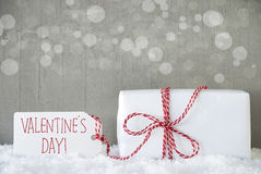 Gift, Cement Background With Bokeh, Text Valentines Day. One Christmas Gift Or Present On Snow. Cement Wall As Background With Bokeh. Modern And Urban Style royalty free stock photos