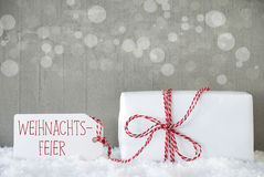 Gift, Cement Background With Bokeh, Weihnachtsfeier Means Christmas Party Stock Photos