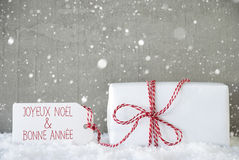 Gift, Cement Background With Snowflakes, Bonne Annee Means New Year Royalty Free Stock Photography