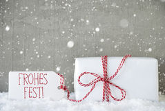 Gift, Cement Background With Snowflakes, Frohes Fest Means Merry Christmas Stock Photo