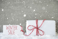 Gift, Cement Background With Snowflakes, Text Winter Sale Stock Photo