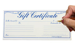 Gift Certificate. A gift certificate with a hand holding a pen isolated on a white background, gift certificate royalty free stock photo