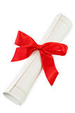 Gift certificate. Rolled certificate with a red ribbon royalty free stock photography