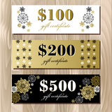 Gift certificate card template with golden snowflakes design. Royalty Free Stock Photos