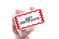Gift certificate. Concept card hold by hand isolated on white background stock images