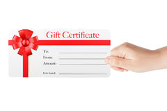 Gift Certificate with Red Ribbon and Bow. In Woman's Hand on a white background stock images