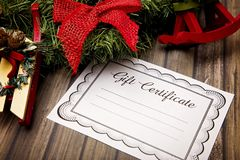 Gift Certificates. Advertisement for Gift Certificates on a Wooden Table royalty free stock images