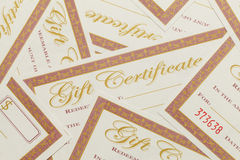 Gift Certificates Pile. Messy Pile of Blank Gift Certificates Background Stock Photography
