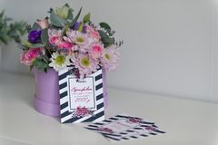 Gift certificates on the table 9107. Certificates on the table near the pot of flowers stock images