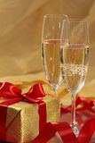 Gift and champagne Stock Photography