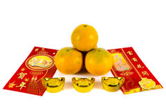 Gift for chinese new year festival. Four oranges and red envelope with chinese blessing word are gift for chinese new year festival Royalty Free Stock Images