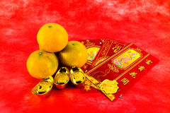 Gift for chinese new year festival. Four oranges and red envelope with chinese blessing word are gift for chinese new year festival Stock Photos