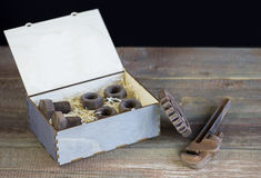 Gift chocolate. Chocolate gift box on a wooden background royalty free stock photos