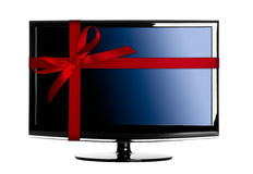 Gift for Christmas. Modern Led tv with a red Christmas ribbon Royalty Free Stock Photos