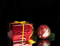 Gift,Christmas ball on the branch of a tree Royalty Free Stock Image