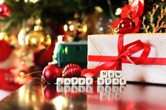 Gift christmas ball and train. Gift with christmas ball and train on taable Royalty Free Stock Photo
