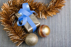 Gift and christmas balls in silver tablecloth background Stock Photo