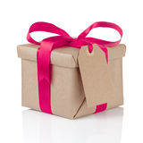 Gift christmas box wrapped with kraft paper and purple bow. Isolated Royalty Free Stock Photo