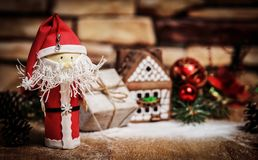 Gift for Christmas ,gingerbread house, a toy Santa Claus. Photo with copy space royalty free stock image